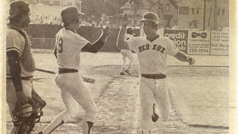 Future Hall of Famer Wade Boggs congratulates Marty Barrett as he scores the winning run.